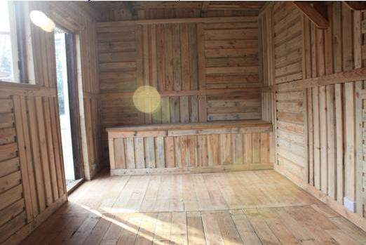 Wood shed from recycled wooden pallets building with pallets